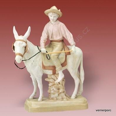 Porcelánová soška chlapce na oslíku, bronzovaná Royal Dux Bohemia